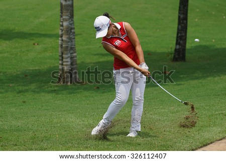 KUALA LUMPUR, MALAYSIA - OCTOBER 09, 2015: South Korea's Sei Young Kim hits from outside the 18th hole green at the KL Golf & Country Club at the 2015 Sime Darby LPGA Malaysia golf tournament. - stock photo