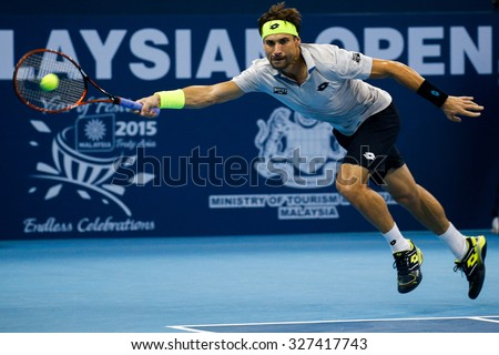 KUALA LUMPUR, MALAYSIA - OCTOBER 03, 2015: Spain's tennis player David Ferrer stretches to make a forehand return at the 2015 Malaysian Open tennis tournament held in the Stadium Putra. - stock photo