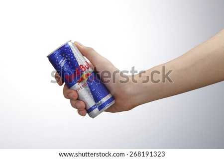 Kuala Lumpur,Malaysia 9th April 2015,Hand holding Can of Red Bull Energy Drink isolated on white background. - stock photo