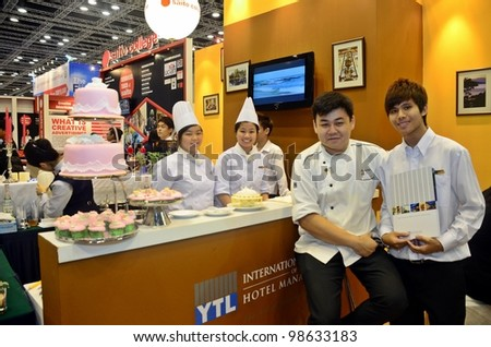 KUALA LUMPUR-MARCH 17: International College of Hotel Management promote the exhibition during the Falcon Education Fair 2012 at Kuala Lumpur Convention Centre (KLCC) March 17, 2012 in Kuala Lumpur. - stock photo