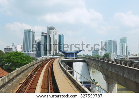 KUALA LUMPUR - MAY 14: View of a RapidKL LRT track running through the city centre on May 14, 2013 in Kuala Lumpur, Malaysia. RapidKL's transport network serves approximately 690,000 passengers daily. - stock photo