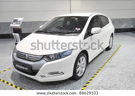 KUALA LUMPUR-NOV.12:Honda Hybrid Insight car at Car of The Year 2U Autoshow (COTY2U 2011) on November 12, 2011 in Kuala Lumpur, Malaysia.It uses Honda's Integrated Motor Assist (IMA) hybrid technology - stock photo