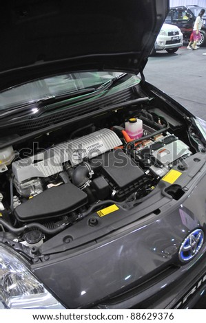 KUALA LUMPUR - NOV. 12 : Toyota Hybrid Prius engine at Car of The Year 2U Autoshow (COTY2U 2011) on November 12, 2011 in Kuala Lumpur, Malaysia. The Prius first went on sale in Japan in 1997. - stock photo