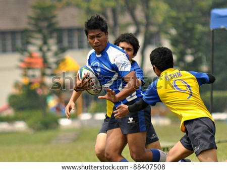 KUALA LUMPUR - OCT. 15: Unidentified players in action during Rugby 10s Tournament Vice-Chancellor Cup at National Defense University Of Malaysia on October 15, 2011 in Kuala Lumpur, Malaysia. - stock photo