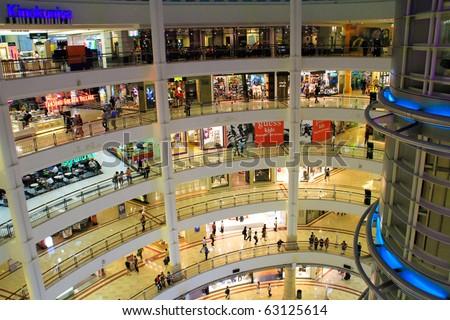 KUALA LUMPUR - OCTOBER 14: Interior of Suria KLCC on October 14, 2010 in Kuala Lumpur, Malaysia. Suria KLCC is the ultimate luxury shopping destination in Malaysia. - stock photo