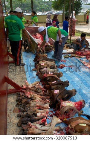 KUALA LUMPUR-SEP 24: Malaysian Muslim gather meat before distribute to the poor and homeless during Eid Al-Adha Al Mubarak,the Feast of Sacrifice September 24, 2015 in Kuala Lumpur, Malaysia - stock photo