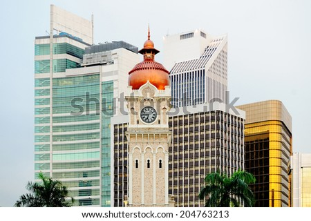 Kuala Lumpur. Tower of Sultan's palace on the background of skyscrapers - stock photo
