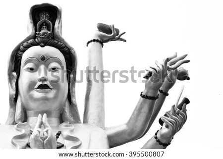 Kuan Yin. goddess of mercy showing a lot of hands sitting on lotus statue - stock photo