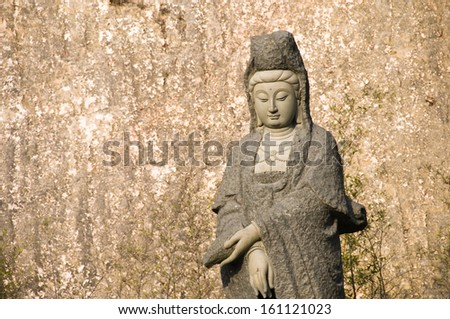 Kuan Yin, statue of Chinese buddha - stock photo