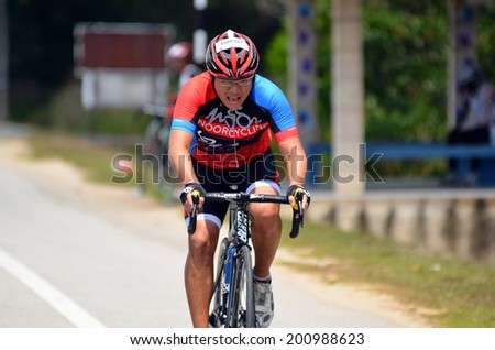 KUANTAN - JUNE 1: unidentified cyclist in action during Kuantan160 on June 1, 2014 in Kuantan, Pahang, Malaysia. KUANTAN160 is a non-profit, non-race 160KM bicycle ride around Kuantan City. - stock photo