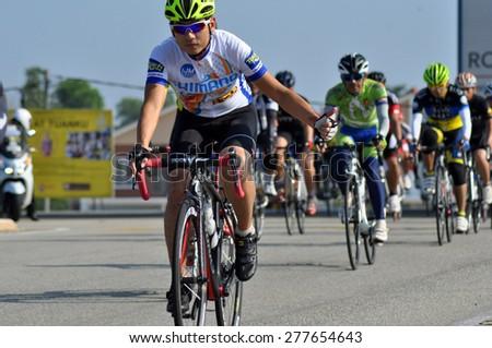 KUANTAN - JUNE 1: unidentified cyclists in action during Kuantan160 on June 1, 2014 in Kuantan, Pahang, Malaysia. KUANTAN160 is a non-profit, non-race 160KM bicycle ride around Kuantan City. - stock photo