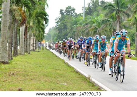 KUANTAN - MARCH 1: Unidentified cyclists in action during Stage 7 of the le Tour de Langkawi from Bentong to Kuantan on March 1, 2012 in Kuantan, Pahang, Malaysia. - stock photo