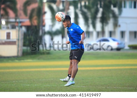 Kuantan, Pahang - April 8: Fauzi Roslan heads the ball during the training Pahang FC Team at Taman Gelora field for preparation next match for Malaysian Super League - stock photo