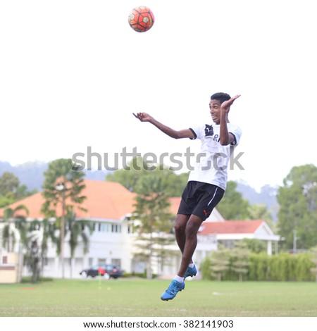 Kuantan, Pahang - JAN 28: Pahang defender Mohd Ridwan heads the ball during the training Pahang FC Team at Taman Gelora field - stock photo