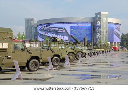 KUBINKA, MOSCOW OBLAST, RUSSIA - JUN 15, 2015: International military-technical forum ARMY-2015 in military-Patriotic park. Visitors view the exhibited military vehicles - stock photo