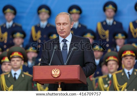 KUBINKA, MOSCOW OBLAST, RUSSIA- JUN 16, 2015: The President of the Russia Vladimir Vladimirovich Putin  with eyes closed at the opening ceremony of the International military-technical forum ARMY-2015 - stock photo