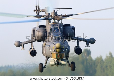 KUBINKA, MOSCOW REGION, RUSSIA - JUNE 14, 2015: Mil MI-28N RF-95325 attack helicopter takes off at Kubinka air force base. - stock photo