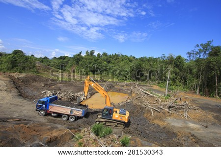 KUCHING, MALAYSIA - MAY 25 2015: Deforestation. Environmental damage to rainforest in Borneo, nature destroyed for oil palm plantations and construction. - stock photo
