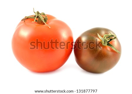 Kumato tomato and red tomato on a white background - stock photo