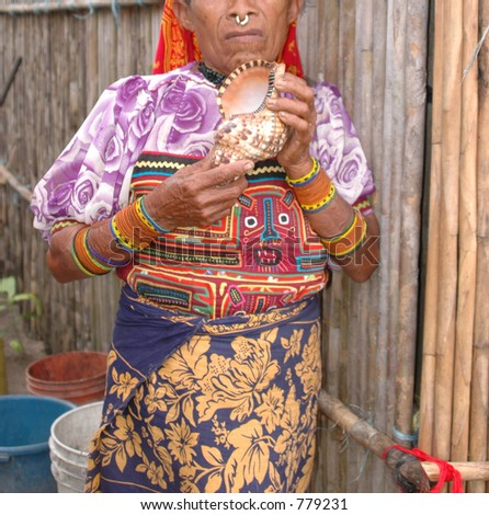 kuna indian in native clothes selling sea shell panama 1083 - stock photo