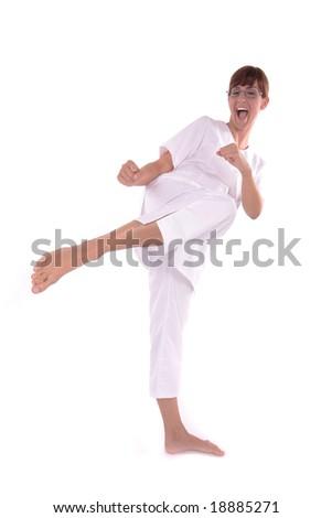 kung fu lady making barefoot kick - focus on feet - stock photo