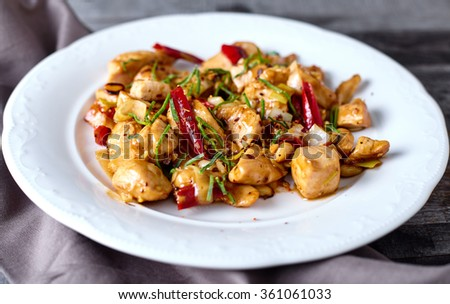 Kung Pao Chicken on wood background - stock photo