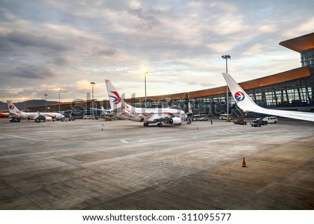 KUNMING-JUNE 20, 2015. Boeing 737 from China Eastern Airline parked at Kunming Changshui International Airport. It is the primary airport serving Kunming, the capital of Yunnan Province, China. - stock photo