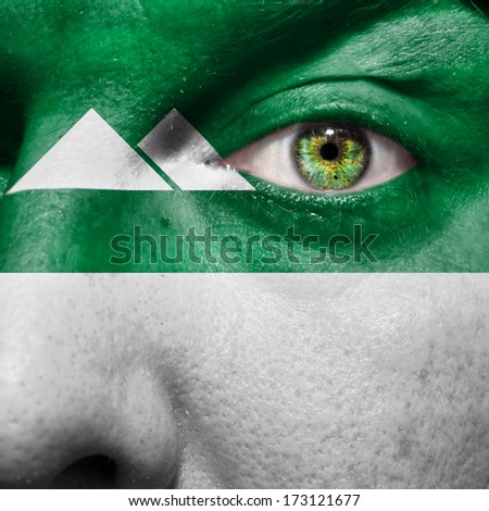 Kurgan flag painted on a man's face to show support for Kurgan in Russia - stock photo