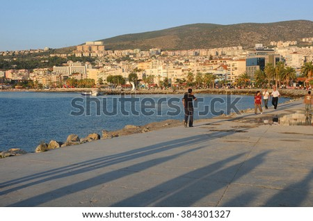 KUSADASI, TURKEY - OCTOBER 4, 2009: View of the residential area and the harbor at sunset - stock photo