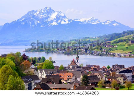 Kussnacht am Rigi old town with Pilatus mountain and Lake Lucerne in background, Switzerland - stock photo