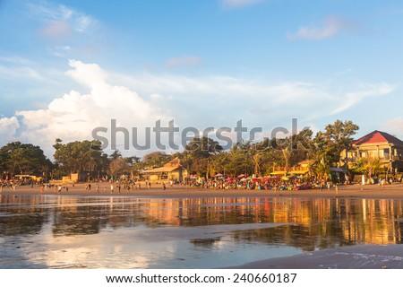 Kuta beach in Seminyak in south Bali at sunset, Indonesia - stock photo