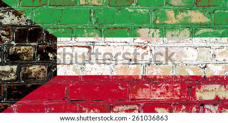 Kuwait flag painted on old brick wall texture background - stock photo