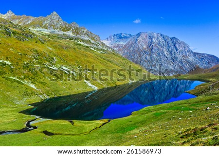 Kyafar lake -one of the biggest in mountains of north Caucasus with panoramic view at the valley. Picture was taken during trekking hike in Caucasia at autumn, Arhiz region,Karachay-Cherkessia,Russia  - stock photo
