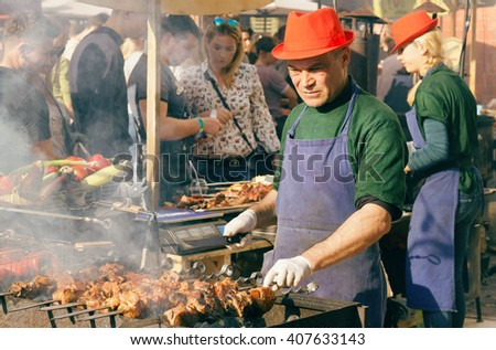 KYIV, UKRAINE - APR 17: Barbecue cook preparing meat outdoor during Street Food Festival on April 17, 2016. Kiev is the 8th most populous city in Europe. - stock photo