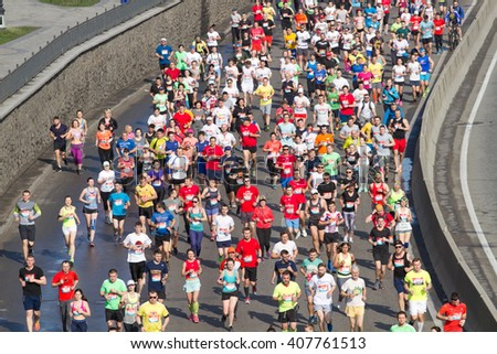 KYIV, UKRAINE - APRIL 17, 2016:Kiev half marathon in Kyiv, Ukraine. The number of runners were more than eight thousand people. - stock photo
