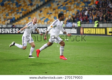 KYIV, UKRAINE - APRIL 16, 2015: Lens and Vida of Dynamo Kyiv after the scored goal during their UEFA Europe League game with Fiorentina at NSC Olimpiyskiy stadium on April 16, 2015 in Kyiv, Ukraine. - stock photo
