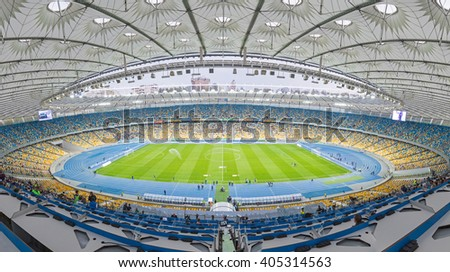 KYIV, UKRAINE - APRIL 10, 2016: Panoramic view of NSC Olympic stadium (NSC Olimpiyskyi) during Ukraine Premier League game FC Dynamo Kyiv vs FC Volyn in Kyiv, Ukraine - stock photo