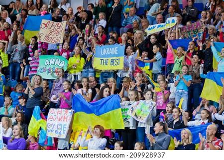 KYIV, UKRAINE - AUGUST 30, 2013: People support Ukrainian gymnasts during 32nd Rhythmic Gymnastics World Championship (Individual All-Around competition) - stock photo