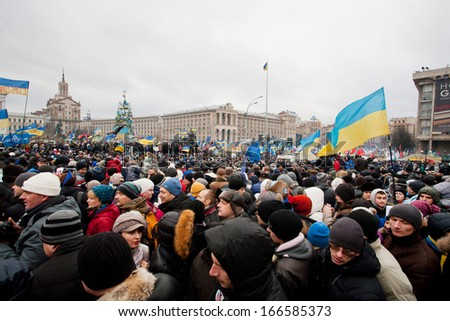 KYIV, UKRAINE - DEC 8: Crazy crowd on the occupying Maidan square moving on the demostration during two weeks anti-government protest on December 8, 2013, in Kiev, Ukraine. - stock photo