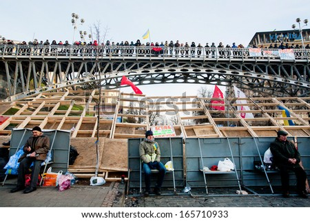 KYIV, UKRAINE - DEC 2: Many people on the city bridge and by barricades meet on anti-government demonstration during the week of pro-European protest on December 2, 2013 in Kiev, Ukraine - stock photo