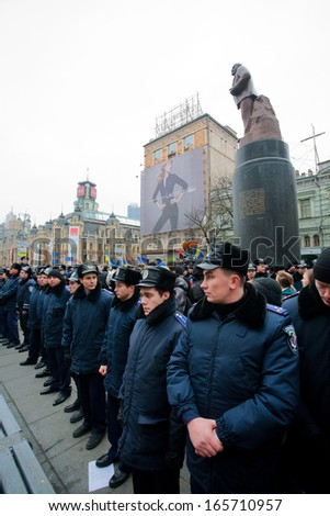 KYIV, UKRAINE - DEC 1: Police forces guarding the monument of the communist leader Lenin during  the pro-European protest on December 1, 2013 in the center of Kiev, Ukraine   - stock photo