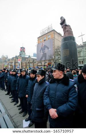KYIV, UKRAINE - DEC 1: Police forces guarding the monument of the communist leader Lenin during  the pro-European protest on December 1, 2013 in the center of Kiev, Ukraine   - stock photo