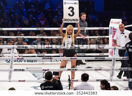 KYIV, UKRAINE - DECEMBER 12, 2015: Boxing ring girls holding a board with round number during WBO Intercontinental cruiserweight Title fight Oleksandr Usyk vs Pedro Rodriguez at Palace of Sports - stock photo