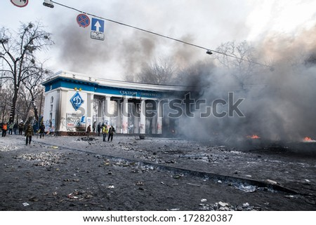 KYIV, UKRAINE - JAN 23: Stadium Dynamo in smoke tubers during anti-government protest Euromaidan on January 23, 2014, in center of Kiev, Ukraine - stock photo