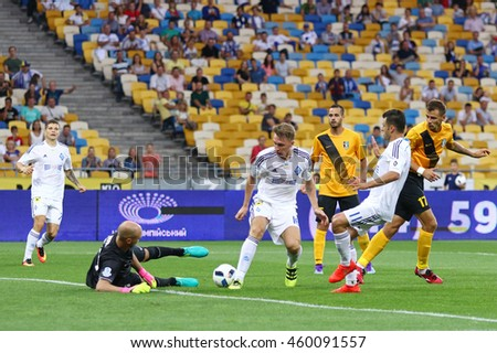 KYIV, UKRAINE - JULY 23, 2016: FC Dynamo Kyiv (in White) and FC Oleksandria players fight for a ball during their Ukrainian Premier League game at NSC Olympic stadium in Kyiv - stock photo