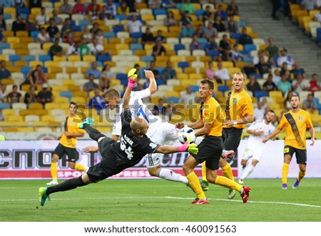 KYIV, UKRAINE - JULY 23, 2016: Oleksandr Gladkyy of FC Dynamo Kyiv (in White) fights for a ball with FC Oleksandria players during Ukrainian Premier League game at NSC Olympic stadium in Kyiv - stock photo