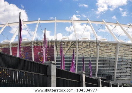 KYIV, UKRAINE - JUNE 2: Fence around National Olympic stadium in Kyiv (NSC Olimpiyskyi), the main Euro-2012 final game stadium from West side, sunny day on June, 2, 2012 in Kyiv, Ukraine - stock photo