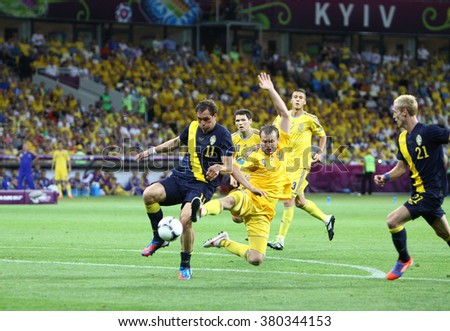 KYIV, UKRAINE - JUNE 11, 2012: Johan Elmander of Sweden (#11) fights for a ball with Oleh Gusev (#9) of Ukraine during their UEFA EURO 2012 game at Olympic stadium in Kyiv - stock photo