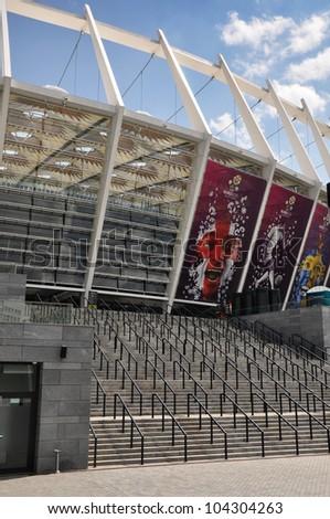 KYIV, UKRAINE - JUNE 2: National Olympic stadium in Kyiv (NSC Olimpiyskyi), the main Euro-2012 final game stadium, central stairs, sunny day on June, 2, 2012 in Kyiv, Ukraine - stock photo