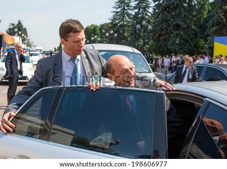 KYIV, UKRAINE - 08 JUNE 2014: President of Romania Traian Basescu is sits in the car after ceremony the inauguration of Ukrainian President Poroshenko June 08 2014 in Kyiv, Ukraine - stock photo